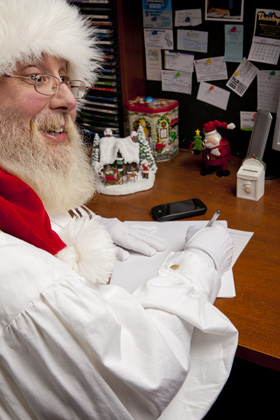 Santa writing a letter to a child