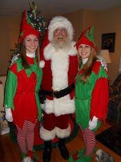 Santa and his helpers in front of the Christmas tree! Dec 2011 Added 12/28/11