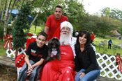 Santa with a happy puppy and his famliy! Annes puppies reunion June Added 7/6/13