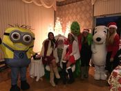 Santa with A Minion The Grinch Snoopy and of course the ladies from Hawaiian Tanning at Candy Cane Lane. 2015 Added 1/2/16
