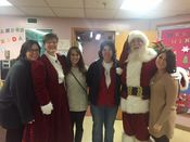 Santa and Mrs Claus with the staff from Cornell Companions and Cornell Cooperative Extension at the Neighborhood center! 2015 Added 1/2/16